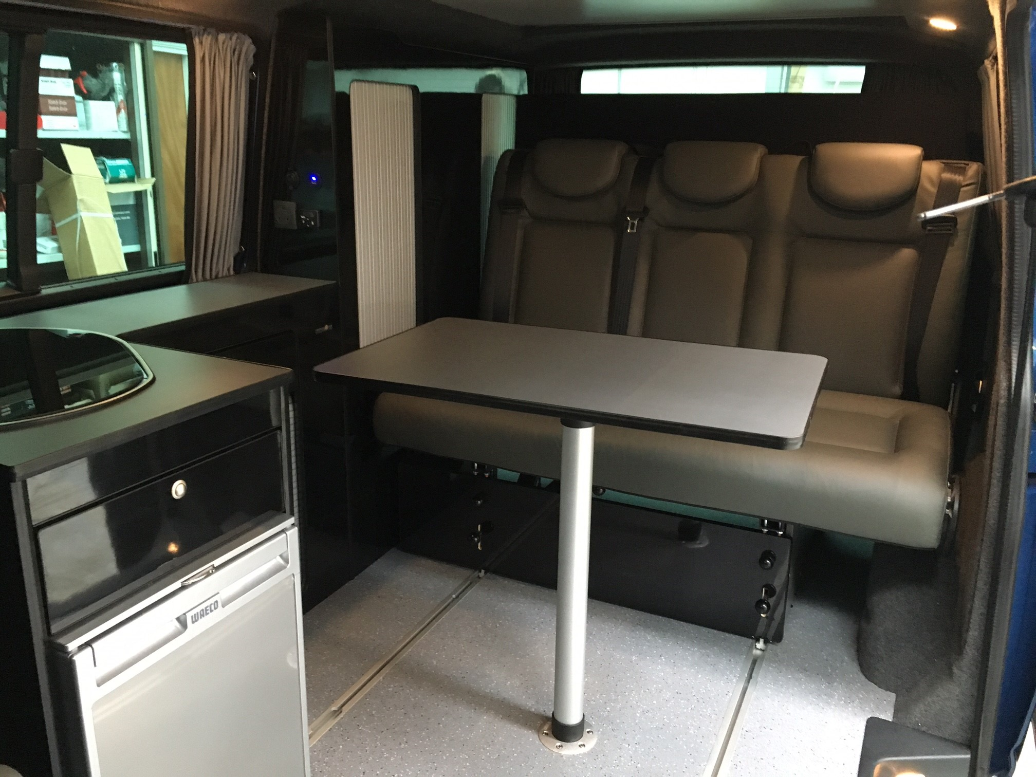 Reimo seat on rails Vauxhall Vivaro Rear Conversion Revampavan - VW Camper Conversions Bournemouth Dorset UK